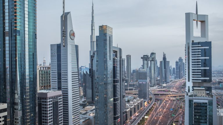 View of Dubai from Hotel Four Points by Sheraton's terrace along Sheikh Zayed Road at sunset.