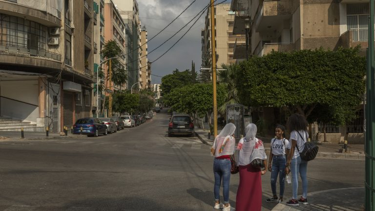 BEIRUT, LEBANON: Genny (right) and Rosa (2nd from right) meet friends (who wished to remain anonymous) in the Beirut suburb of Badaro on their day off. They are both employed as domestic workers and have been in Lebanon for four years.  Credit: Jacob Russell for Rest of World