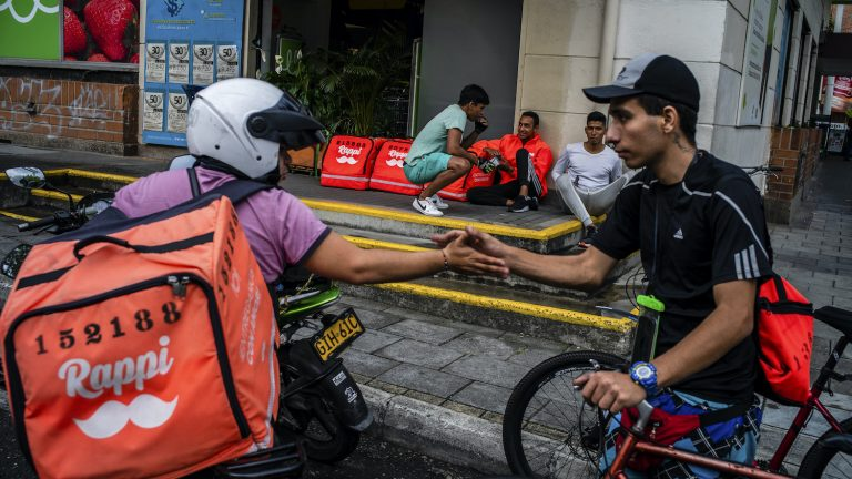 A group of Rappi messengers waiting for orders in Medellin, Colombia, Oct. 7, 2019. This year SoftBank gave Rappi $1 billion, twice as much as what the company had gotten from all its previous investors combined.