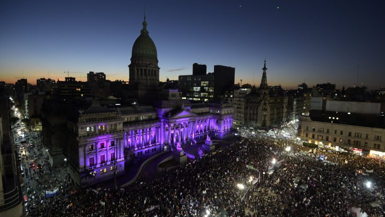 People gather in front of the Congress building to take part in a demonstration
