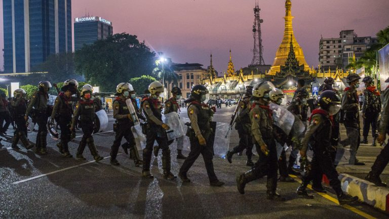 Riot police leave their positions blocking a road after protestors dispersed following a peaceful demonstration against the military coup of 1 February 2021 and in support of the NLD (National League for Democracy), Aung San Suu Kyi and democracy.    Creation Date: Myanmar
