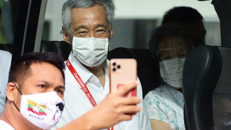 A supporter takes a selfie with with Prime Minister Lee Hsien Loong during the general election on July 10, 2020 in Singapore.