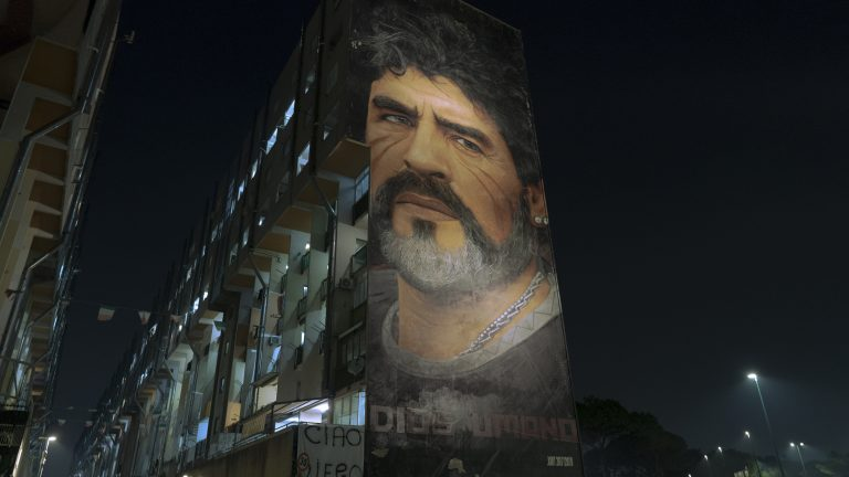 NAPLES, ITALY - NOVEMBER 25: A huge mural representing Diego Armando Maradona is visible on the facade of a building in the San Giovanni district on November 25, 2020 in Naples, Italy. (Photo by Roberto Salomone/Archivio Roberto Salomone/Mondadori Portfolio via Getty Images)