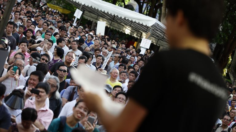 SINGAPORE - JUNE 07:  Roy Ngerng speaks during the 'Return Our CPF' protest at the Speakers' Corner at Hong Lim Park on June 7, 2014 in Singapore. Roy Ngerng is locked in a legal dispute with the Prime Minister of Singapore about an alleged defamatory article on the Singaporeans' CPF saving posted by Roy. Through crowd funding, Roy has managed to raise more than $90,000 for his legal defence fund within a week. The protest was staged to demand greater transparency and accountability from the government on how the CPF monies are being utilized.  (Photo by Suhaimi Abdullah/Getty Images)