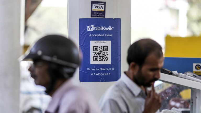 Signage for digital payment service MobiKwik, operated by One MobiKwik Systems Pvt., is displayed at a Bharat Petroleum Corp. fuel station in Bengaluru, India, on Saturday, Feb. 4, 2017. A relative laggard in digital transactions, India has more recently seen 50 percent year-on-year growth, according to a study by Google and Boston Consulting Group. The pace may accelerate with demonetization giving digital wallets like Paytm, MobiKwik and Freecharge an extra push. Photographer: Dhiraj Singh/Bloomberg via Getty Images