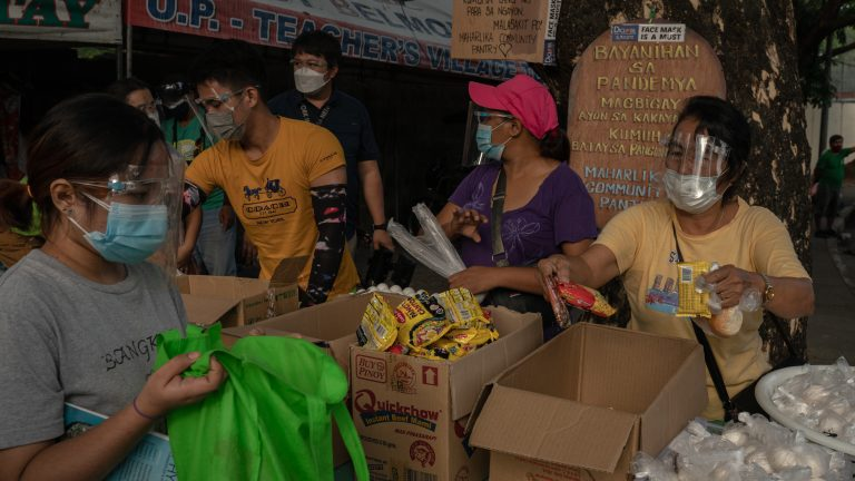 Volunteers at the Maharlika Street Community Pantry disseminate donations in Quezon City on April 27, 2021. Hundreds of community pantries sprouted in the Philippines after Patreng Non, a 26-year artist, set-up a small community pantry in her street in Quezon City and became viral in social media two weeks ago.