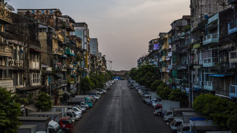 A usually busy downtown road in Yangon, Myanmar, on Wednesday, March 24, 2021, is nearly deserter during a