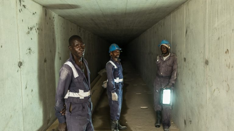 Construction workers inside one of the underground utility tunnels at Konza City.