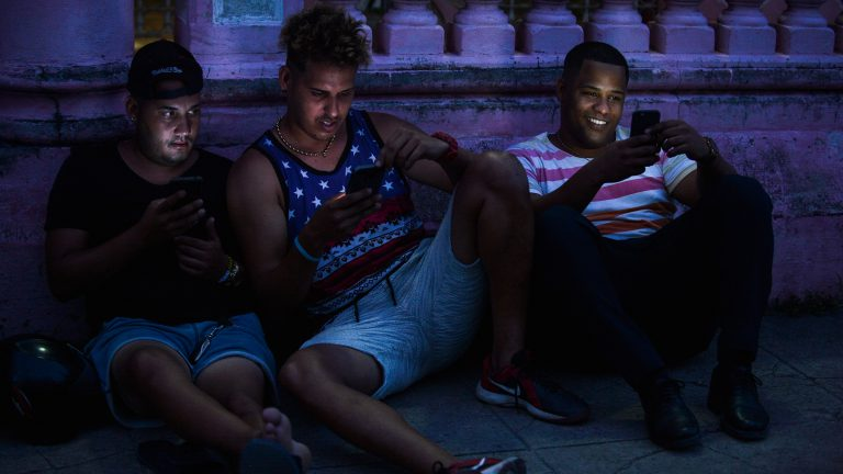 Young Cubans connect to internet from their mobile phone in Havana, on June 6, 2019. - Cubans do not hide their frustration six months after the arrival of mobile internet to the island as the connectivity is too expensive, slow and censored by the government. (Photo by YAMIL LAGE / AFP) (Photo by YAMIL LAGE/AFP via Getty Images)