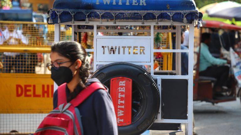 Twitter written on a Rickshaw is seen outside a Metro station in New Delhi.