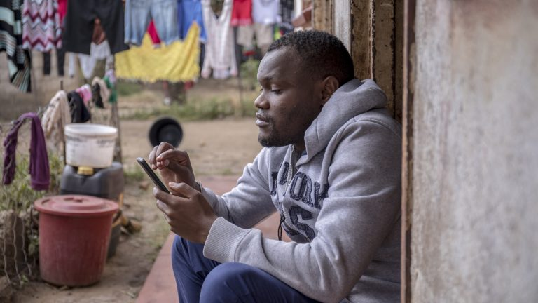 Maxwell Chimedza, a tutor who uses WhatsApp, teaches at his home in Mbare, Harare.