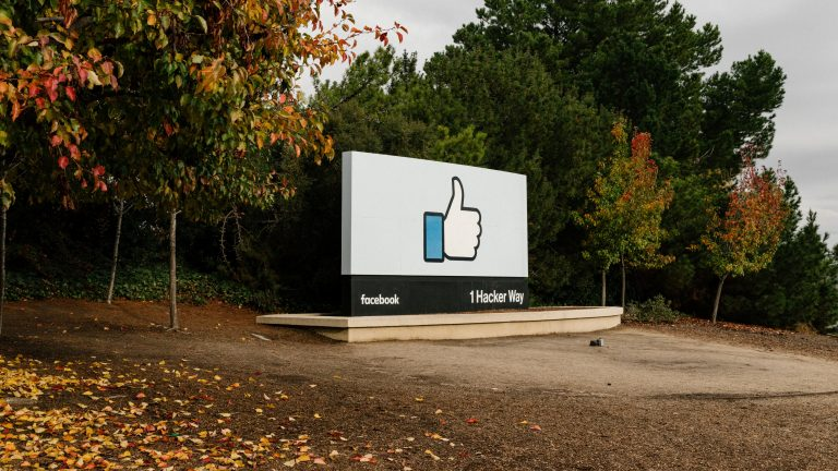 FILE -- A sign that incorporates Facebook's ubiquitous