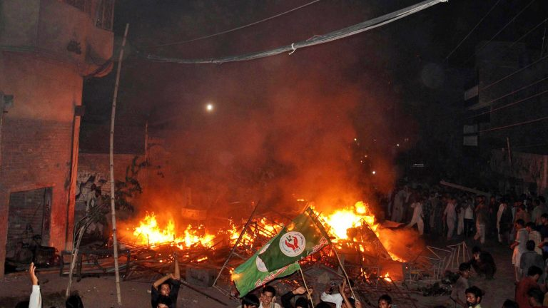 A mob set fire Ahmadi houses after a cleric issued a fatwa against a local Ahmadi boy over a Facebook post in the city of Gujranwala in July 2014.