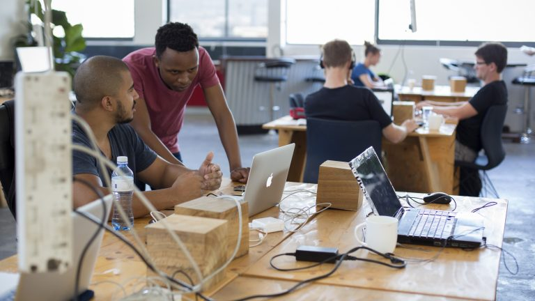 Techies work in a shared office space called Woodstock Exchange, where entrepreneurs and small businesses rent office space on November 22, 2016 in Woodstock outside central Cape Town, South Africa.